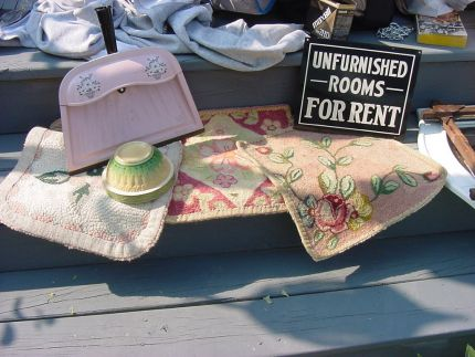 this little vignette is in pink, although im not into pink, i love the hooked seat covers & the pan is cool too :) the yellowware bowl was a snag at a  flea market on memorial day, what a day that was. the rent sign is going on my studio which is currently being inhabited by my daughters cat until shes through moving.