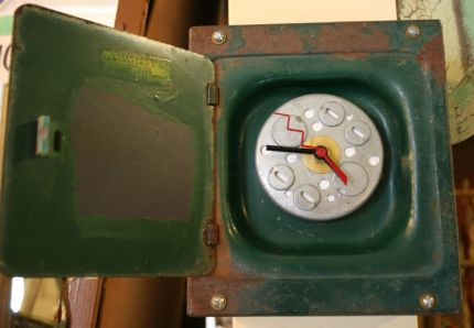 See! you can make a clock out of just about anything! Here's one I made out of a cool old green circuit breaker box. I wanted to keep with the theme of things so I made the clock face out of some other electrical-something-or -other and chose a minute hand that looks like a bolt.