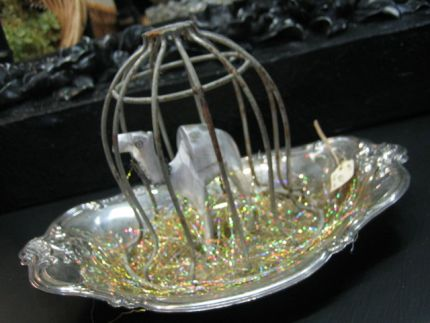Wise Men Still Seek Him . . . .  Love how this turned out.  It is a vintage silver tray, a wood camel I spray painted silver and a silver wire cage turned cloche.  The cloche was purchased this week at an occasional sale store in Buffalo, MN.  Loved it!