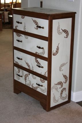 revamped vintage chest of drawers... I wanted the leaves to look as if they were falling and puddling around the bottom.