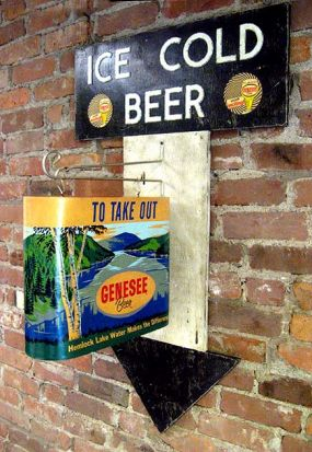 "After cutting the arrow from plywood it was painted and distressed. The old Genesee sign and bracket were then mounted to the front. The ""ICE COLD BEER"" text is actually cardboard letters painted high-gloss white and then chipped  to resemble vintage enamel signage."