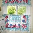 An old tablecloth turned into curtains~perfect for adding vintage style.