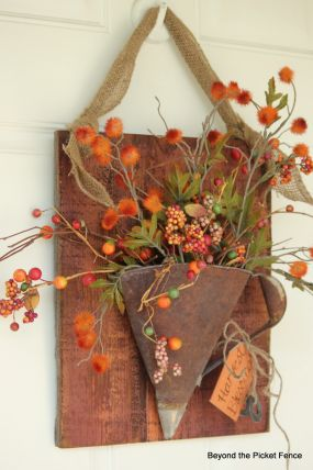 A rusty funnel flattened makes a great place for fall florals